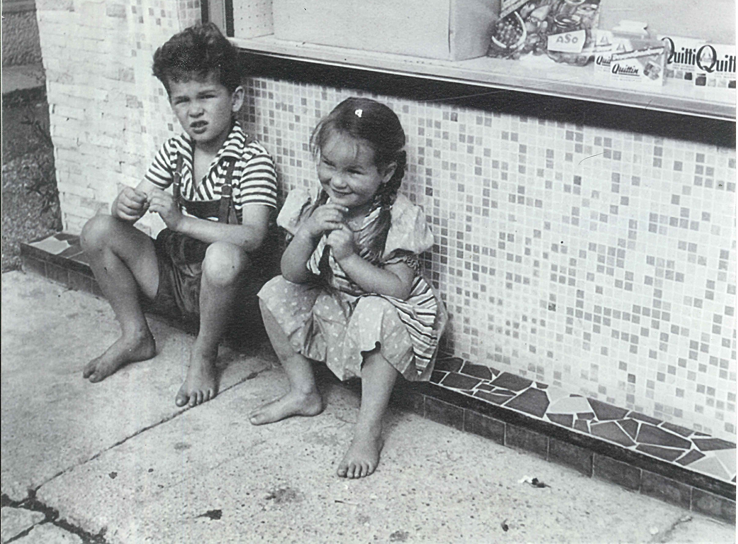 Young Heini Staudinger and his sister in front of their parents grocery
